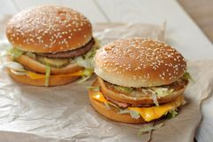 Big burger close-up. On white paper background stock photos