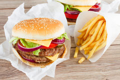 Big burger with french fries Royalty Free Stock Photos