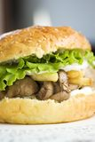 Big burger with liver and crisp Stock Images