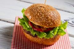 Big burger on napkin. Royalty Free Stock Photography