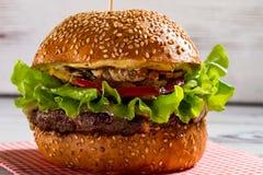 Big burger with sesame buns. stock photo