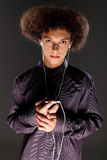 Big bushy afro hair teenager listening to music Stock Photography