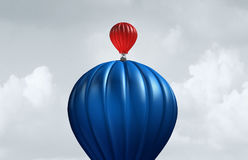 Big Business Assistance. And support financial and corporate concept as a large air balloon lifting up a small entity as a symbol for investment and funding Royalty Free Stock Images
