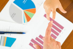 Big business helping small business Stock Image