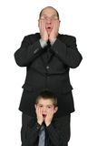Big Business Man and Little Business Man. Together with hands to there face Stock Photos