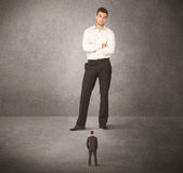Big business man looking at small worker Royalty Free Stock Image