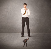 Big business man looking at small worker Royalty Free Stock Photo