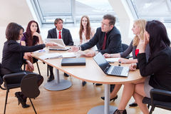 Big business meeting. Seven people having a business meeting in the conference room royalty free stock photo