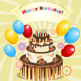 Big cake with candles and balloons Royalty Free Stock Photo