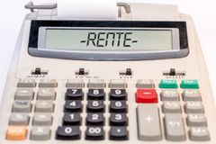Big calculator with the german word for pension in the display stock image