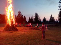 Big camp fire. Tourists watching at a huge camp fire Royalty Free Stock Photo