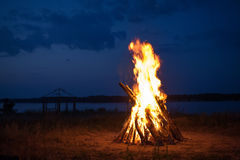 Big campfire. At the river after sunset royalty free stock photography