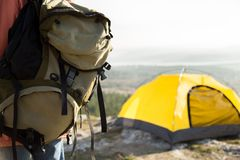 Camping backpack and tent stock photo
