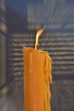 Big candle buddha fire Stock Photos