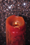 Big candle on a sparkle background Stock Photography