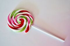 Big candy on a stick of different colors stock image