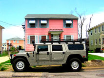 Big car. Who parked in front of my house? - Big SUV car parked in front of a small pink house. This is a real scene pictured in New Orleans, Louisiana Royalty Free Stock Photography