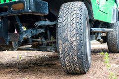Big car wheel on a road. Big car wheel on a road,Off-road tire Stock Photos