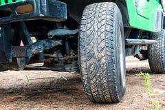 Big car wheel on a road. Stock Photos