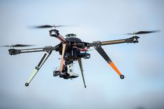 Big Carbon Drone dslr dji summer in the air. With gimbal RC RX with propellers Stock Photography