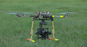 Big Carbon Drone dslr dji summer in the air. With gimbal RC RX with propellers Royalty Free Stock Photography