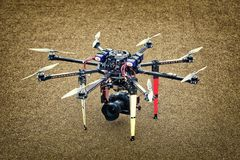 Big Carbon Drone dslr dji summer on the ground. Big Carbon Drone dslr dji summer in the air with gimbal RC RX with propellers Stock Image