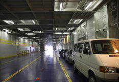 Big cardeck of ferry with few cars Stock Photo