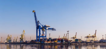 Big cargo crane, freight train and many containers in port Royalty Free Stock Photo