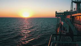 Big Cargo Ferry and Sunset on the Sea stock video footage