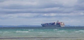 Big cargo ship sailing across Mornington Peninsula Stock Photo