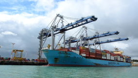 Big cargo ship unloading containers in Ports of Auckland New Zealand