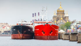 Big cargo ships stand moored on the Neva river Stock Images