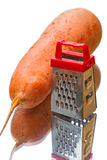 Big carrot and grater Royalty Free Stock Photo