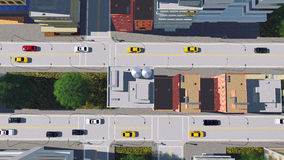 Big cartoon city street traffic aerial view. Straight overhead aerial view of street traffic in abstract cartoon city downtown with modern high rise buildings at Royalty Free Stock Image