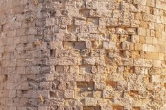 Big castle wall stone architecture building background with burning sun Stock Photography