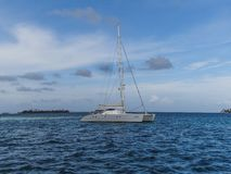 Catamaran and stormy cloud panama central america stock images