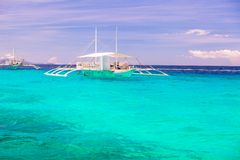 Big catamaran in turquoise open sea near Bohol Royalty Free Stock Images