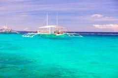 Big catamaran in turquoise open sea near Bohol Royalty Free Stock Images