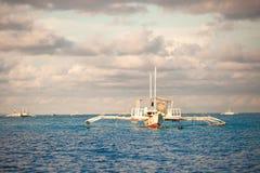Big catamaran in turquoise open  sea near Bohol Stock Photos