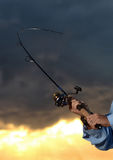 Big catch while fishing with rod and reel Royalty Free Stock Photography
