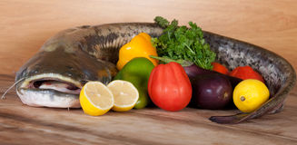 Big catfish with vegetables Stock Images