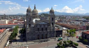 Toluca mexico cathedral. A big cathedral with many saints decorative religious items all over it, main face of the catholic stone building in toluca mexico city Royalty Free Stock Images