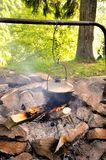 Big cauldron over the fire stock images