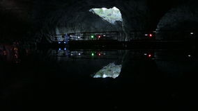 The big cave with panton way on the underground lake and big pieces of ice. stock footage