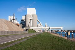 Cement factory near a canal in the Netherlands Royalty Free Stock Photography