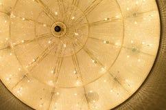 Philharmonic big-sized chandelier. Big chandelier in philharmonic hall Royalty Free Stock Image