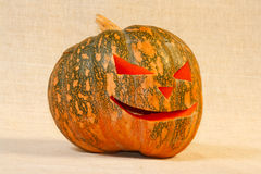 The big cheerful halloween pumpkin. On a canvas background Royalty Free Stock Photography