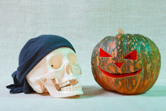 The big cheerful halloween pumpkin and skull. From canvas background Stock Image