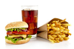 Big cheeseburger with glass of cola and french fries isolated on Royalty Free Stock Image