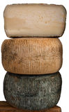 Big cheeses. Three large traditional Cretan graviera cheeses, one of them cut in half Royalty Free Stock Image